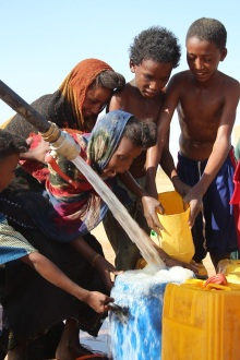 Children playing in clean water for the first time at the Couloubade borehole
